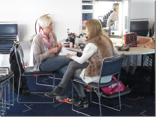 Eva puts on Nell Mooney's makeup for DBA in Space.